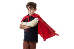 Young boy dreams of becoming a superhero. Royalty Free Stock Images