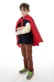 Young boy dreams of becoming a superhero. Stock Photography