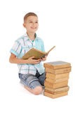Young boy dreams near the open old book Royalty Free Stock Photography