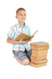 The young boy dreams near the open old book Royalty Free Stock Photo