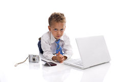 Young boy dressed as businessman with gadgets. Young boy dressed as businessman with electronic gadgets - isolated on white stock photo