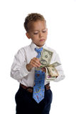 Young boy dressed as businessman holds money Royalty Free Stock Images
