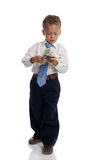 Young boy dressed as businessman holds money. Isolated on white stock images