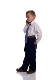 Young boy dressed as businessman with mobile phone. Young boy dressed as businessman talks on the mobile phone - isolated on white Royalty Free Stock Photos
