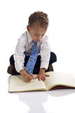 Young boy dressed as businessman with notepad Stock Image