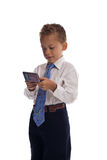 Young boy dressed as businessman sends SMS. Text message - isolated on white Royalty Free Stock Photos
