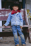 Young boy dressed as cowboy Stock Photo