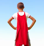 A young boy dressed as superhero, rear view Royalty Free Stock Image