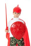 Young Boy Dressed Like a knight. Holding a sword and shield isolated on white Stock Photos