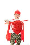 Young Boy Dressed Like a knight. Holding a sword and shield isolated on white Royalty Free Stock Photography