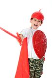 Young Boy Dressed Like a knight. Holding a sword and shield isolated on white Royalty Free Stock Photos