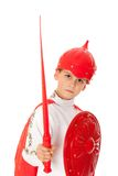 Young Boy Dressed Like a knight. Holding a sword and shield isolated on white Stock Photo