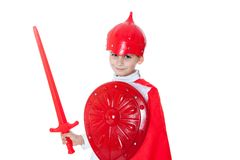 Young Boy Dressed Like a knight. Holding a sword and shield isolated on white Royalty Free Stock Photo