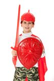 Young Boy Dressed Like a knight. Holding a sword and shield isolated on white Royalty Free Stock Images