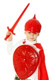 Young Boy Dressed Like a knight. Holding a sword and shield isolated on white Stock Images