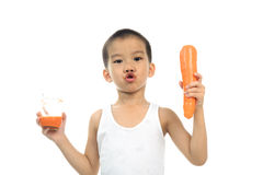 Young boy drink carrot juice Stock Photo