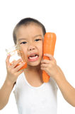 Young boy drink carrot juice Stock Images