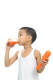 Young boy drink carrot juice Royalty Free Stock Photography
