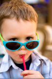 Young boy drinking Royalty Free Stock Photography