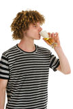 Young boy is drinking beer Royalty Free Stock Photos