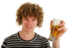Young boy is drinking beer Royalty Free Stock Photography