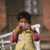 A young boy is drinking a cup of tea Royalty Free Stock Images