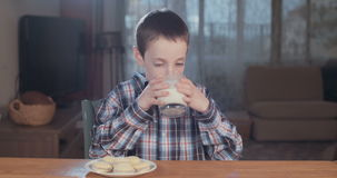Young boy drinking a glass of milk stock video footage