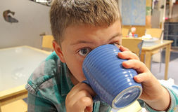Young boy drinking hot beverage drink Stock Photos