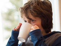 Boy drinking hot chocolate Stock Photos