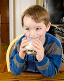 Young boy drinking milk Royalty Free Stock Images