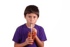 Young boy drinking Royalty Free Stock Images