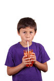 Young boy drinking Stock Images