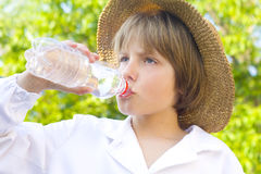 Young boy drinking water Stock Photos