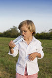 Young boy drinking water outdoors Royalty Free Stock Photo