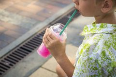 Boy drinks sweet shaved ice stock images