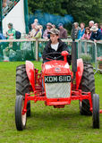 Young Boy driving old Tractor Royalty Free Stock Images