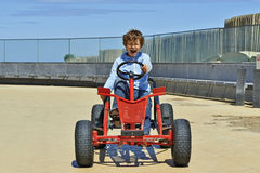 Young boy driving a Quadricycle Stock Photo