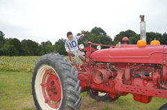 Young boy driving tractor Royalty Free Stock Photo