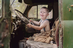 Young boy driving truck royalty free stock image