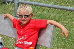 Young Boy in the Dugout in Between Innings Royalty Free Stock Image