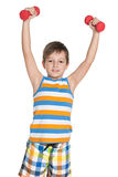 Young boy with dumbbells Royalty Free Stock Images