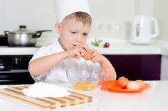 Young boy earning to be a chef Stock Images