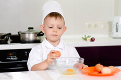 Young boy earning to be a chef Royalty Free Stock Image