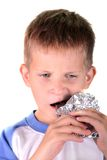 Young boy eat chocolate Royalty Free Stock Image