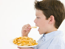 Young boy eating Royalty Free Stock Images