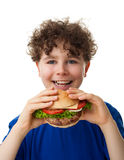 Young boy eating big sandwich. Young boy eating healthy sandwich isolated on white background Royalty Free Stock Photography