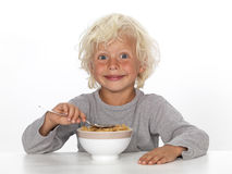 Young boy eating breakfast Royalty Free Stock Photo