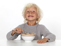 Young boy eating breakfast Stock Photo