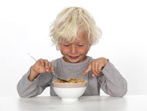 Young boy eating breakfast Stock Images