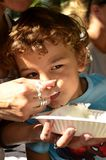 A young boy eating a cake Stock Images
